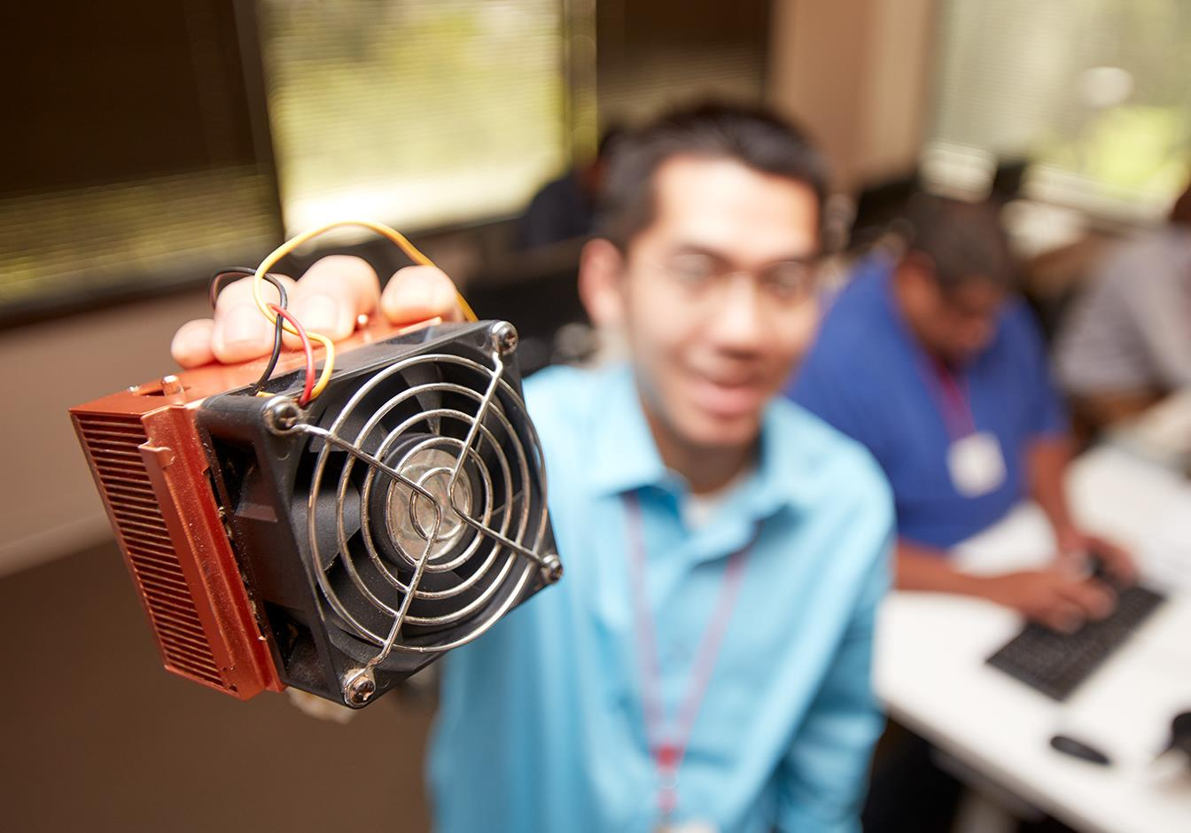 Student Holding Computer Parts